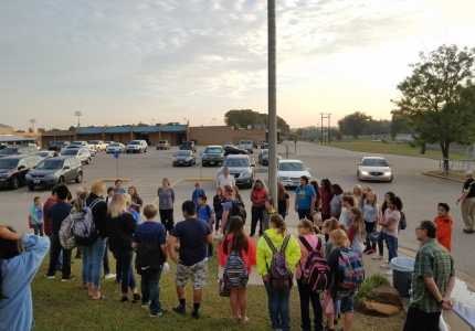 Photo depicting Middle School Students meeting at the pole